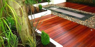 Hardwood Balau Decking with planters and pebble feature