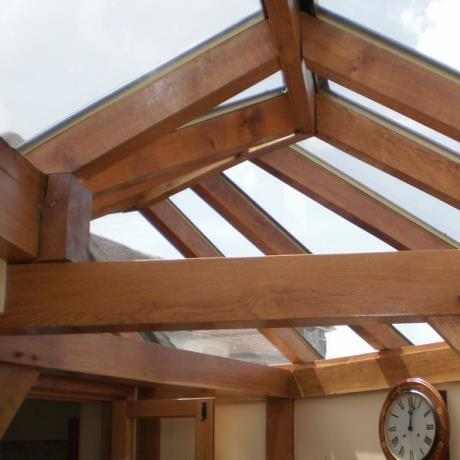 Pictured: Conservatory timber oak frame building / glass extension wood