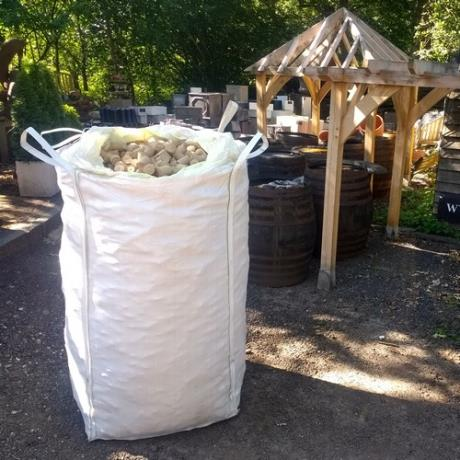 Super bag of mechanically compressed Eco Nuggets produced from eco-friendly wood waste