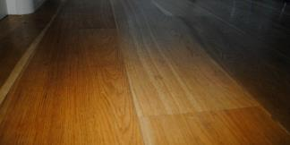 Close up of amber and honey coloured Engineered Flooring boards.