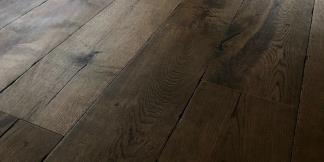 Close up of dark Engineered Flooring in a home gym.