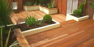 Split-level Hardwood Balau Decking and built-in planters.