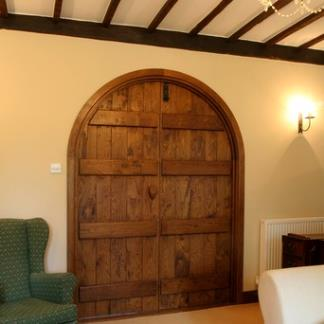 Bespoke Solid Oak Curved Head Doors with Dark Wax Staining