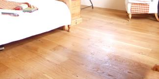 Solid Oak Flooring in bedroom.