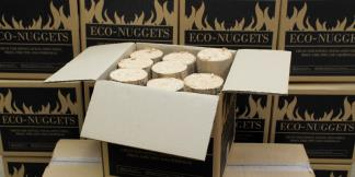 14kg boxes of mechanically compressed Eco-Nuggets produced from eco-friendly wood waste